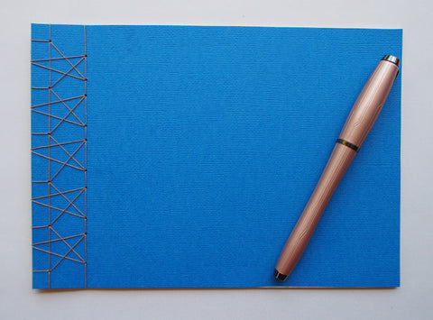Festive special: notebooks with unique hand-bound decorative designs in royal blue with 5 stars binding