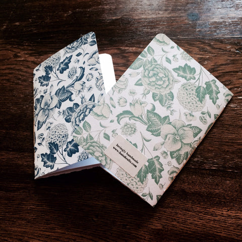 Blue and green hand-bound botanical journals