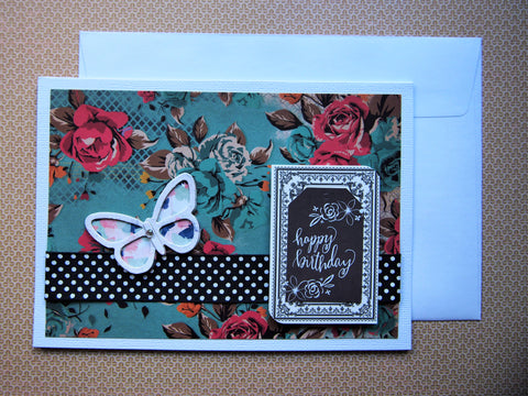Happy birthday card on pretty turquoise floral paper with butterfly embellishment and black accents