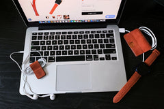 burnt orange Magnetic leather cord wrap set on desk