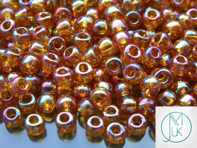 10g 162C Transparent Topaz Rainbow Toho Seed Beads Size 3/0 5.5mm-TOHO Glass Beads-Michael's UK Jewellery