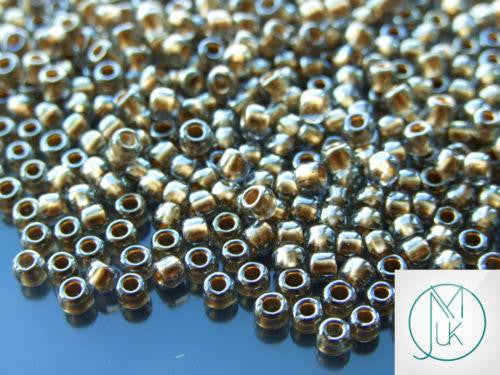 10g 993 Gold Lined Black Diamond Toho Seed Beads 6/0 4mm-TOHO Glass Beads-Michael's UK Jewellery