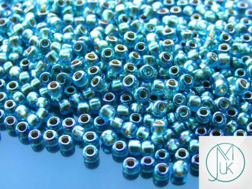 10g 995 Gold Lined Aqua Rainbow Toho Seed Beads 6/0 4mm-TOHO Glass Beads-Michael's UK Jewellery