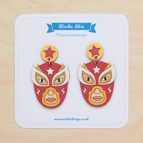 Red luchador dangle earrings