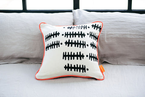 Monochrome Fence cushion eco linen hand printed coral piping front