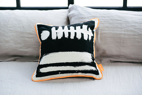 Monochrome Bristle cushion eco linen hand printed orange piping front