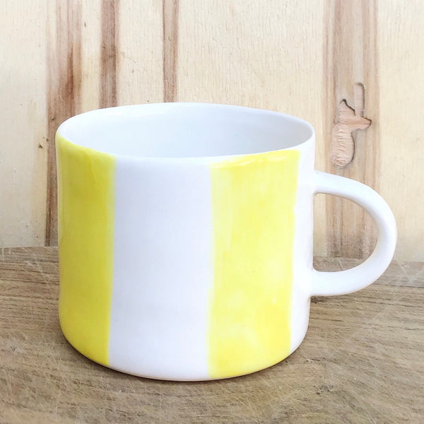 Alberta, light yellow striped cup with a handle, medium size