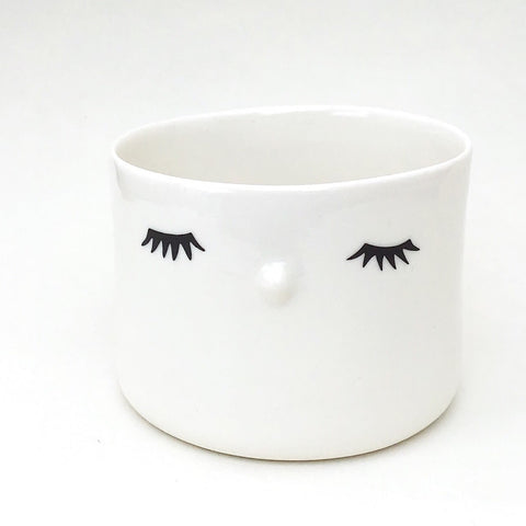 Nosy flower pot, medium size, closed eyes.