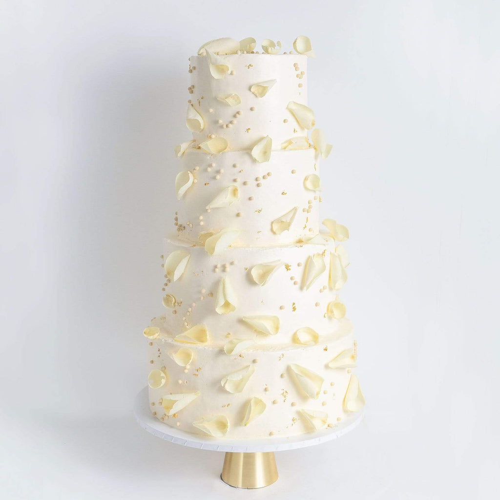 FOUR TIER PETALS AND GOLD WEDDING CAKE