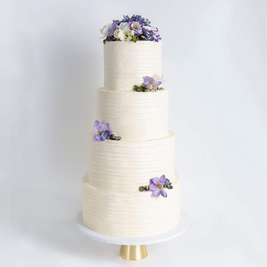 FOUR TIER FLORAL RUFFLE WEDDING CAKE