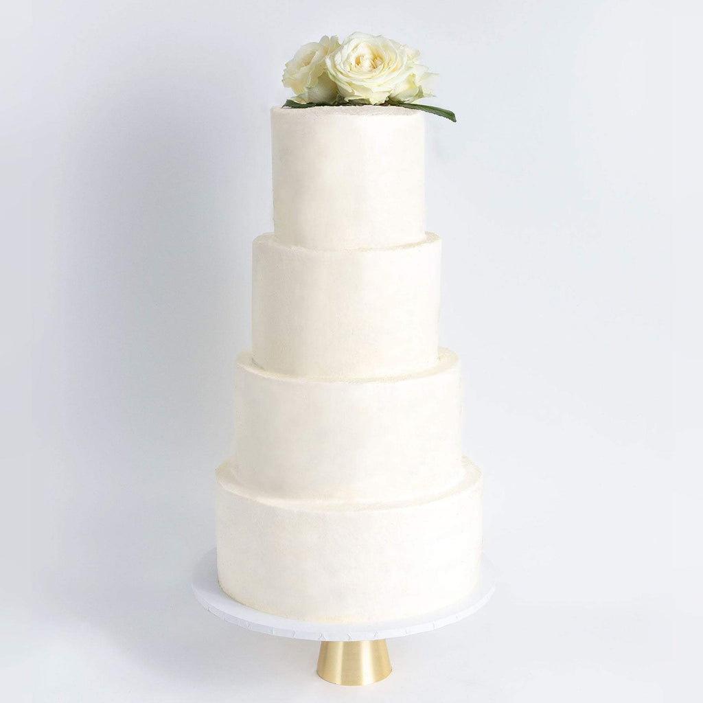 FOUR TIER DECORATED WHITE WEDDING CAKE