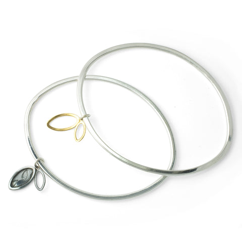'Flourish' oval bangle with charm