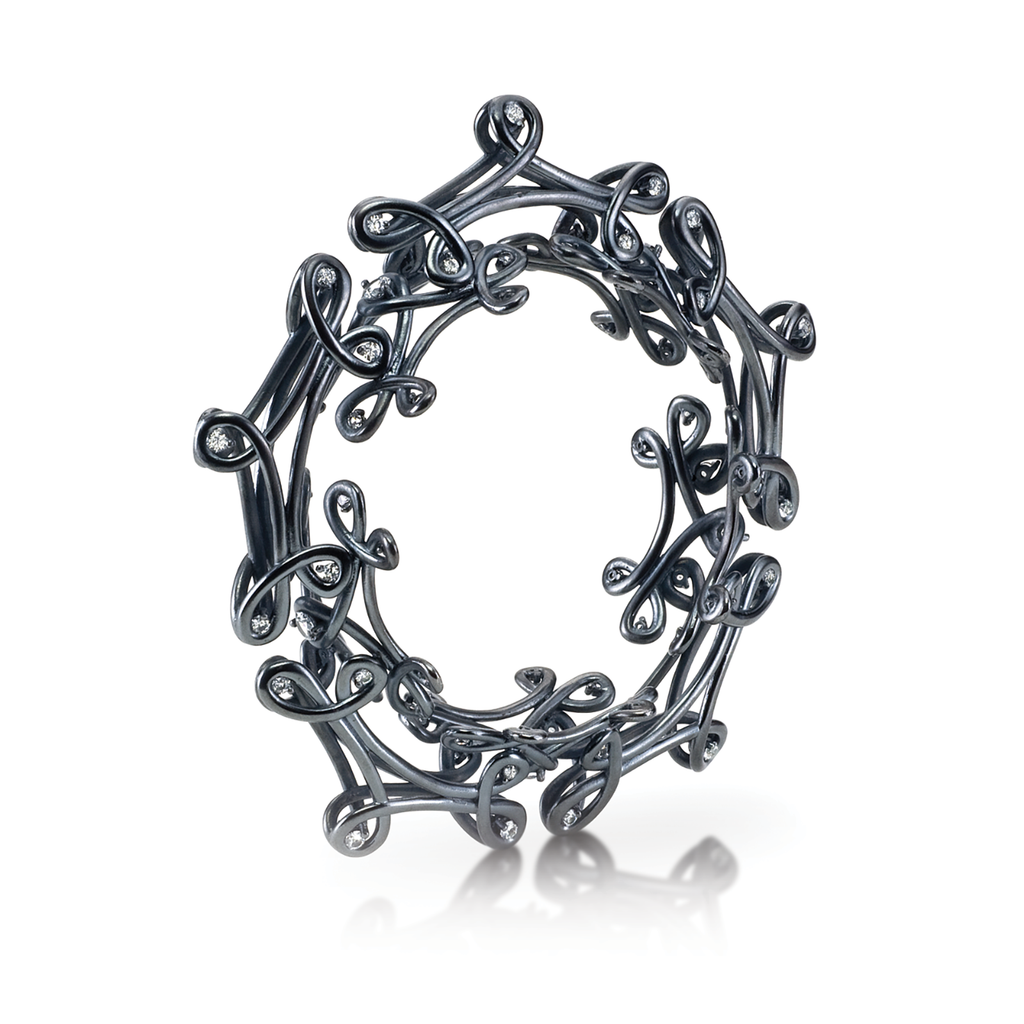 Twisting Unique Kaleidoscope White Sapphire and Black Oxidized Sterling Silver Bracelet by Diana Vincent