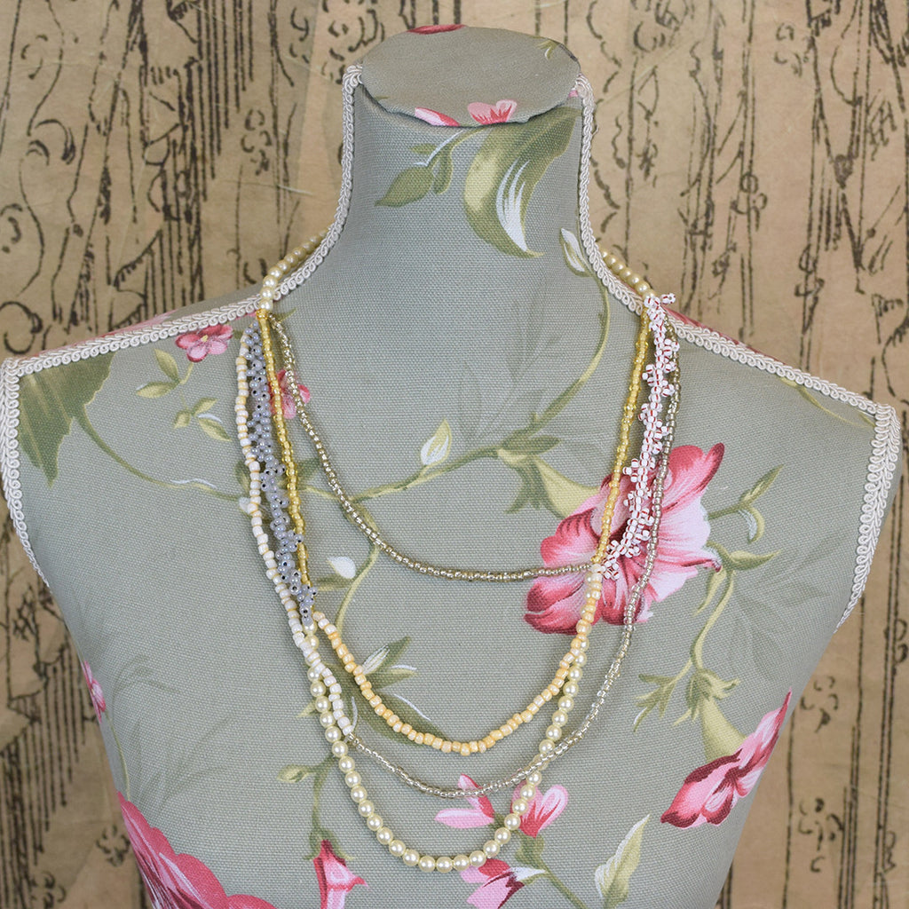 Multi Strand Pearl and Bead Necklace.