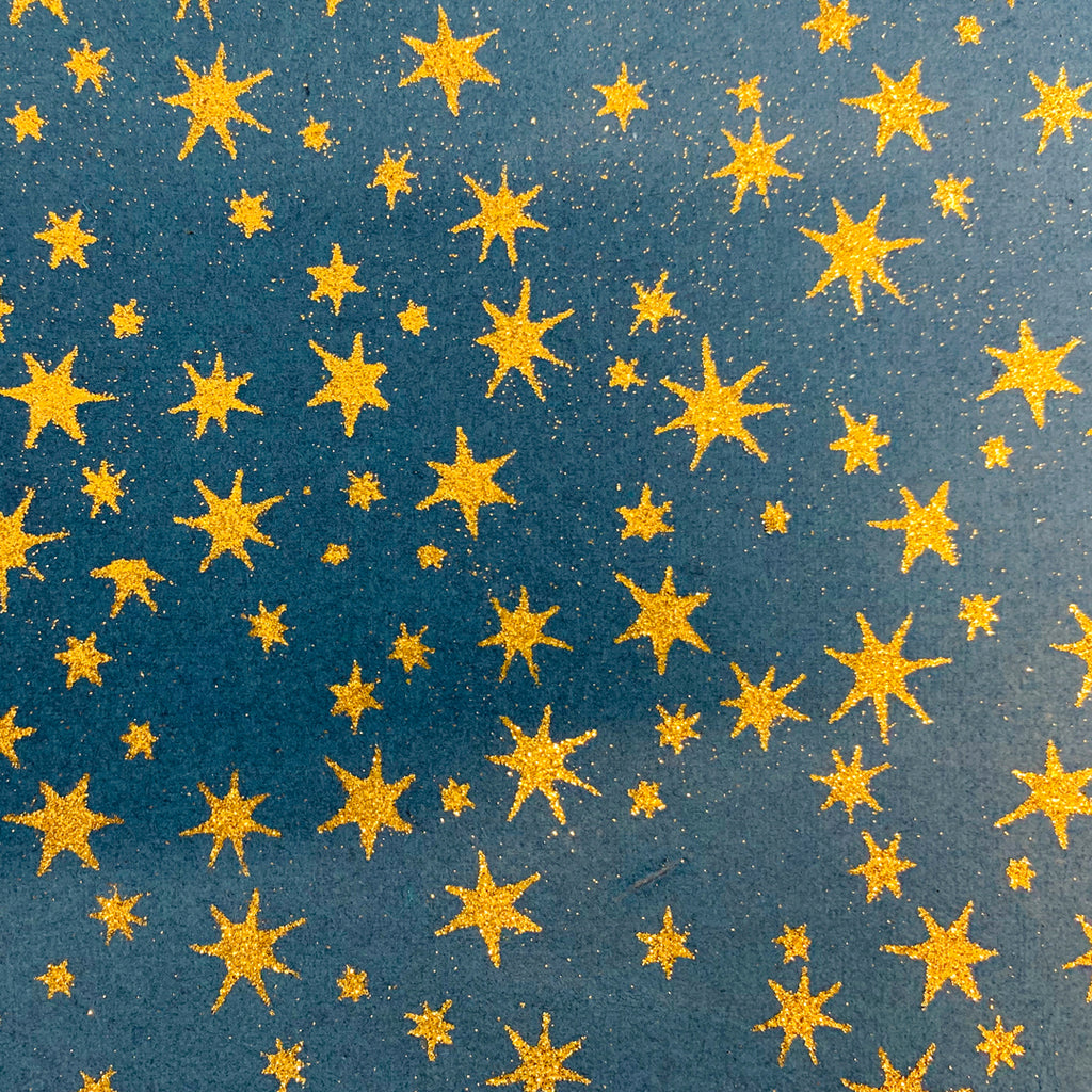 Wrapping Paper. Blue with Gold Stars.