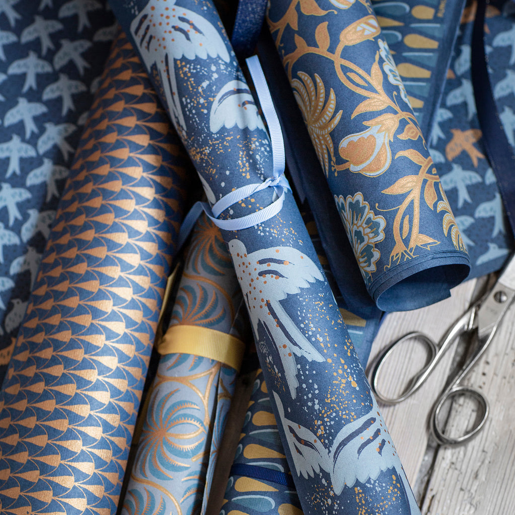 Bungalow Wrapping Paper. Blue and Copper Small Doves