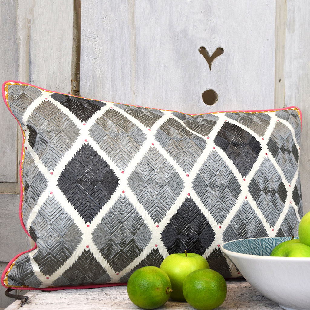 Diamond patterned grey cushion