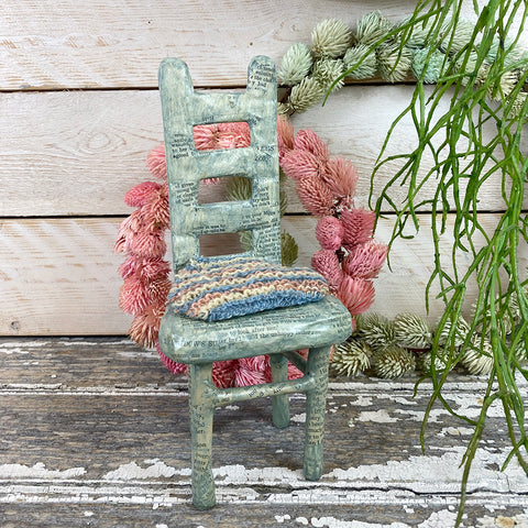 Julie Arkell - 'Green chair with knitted cushion'.
