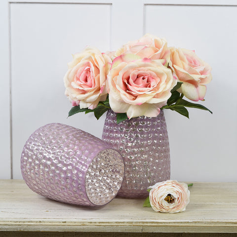 Glass dimpled vase in dusty pink.