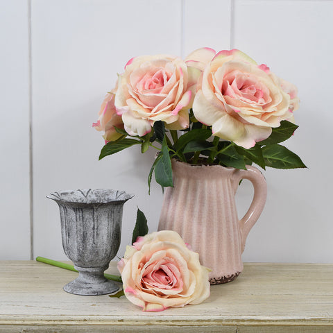 Ceramic jug in antiqued powder pink.