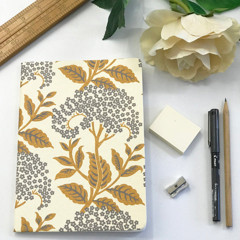 The Bungalow Chavara Gold A5 Notebook. Gold and Grey Floral.