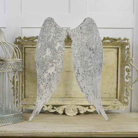 Angel wings in distressed metal finish