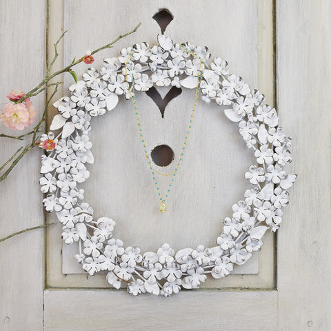 Antique effect white floral wreath