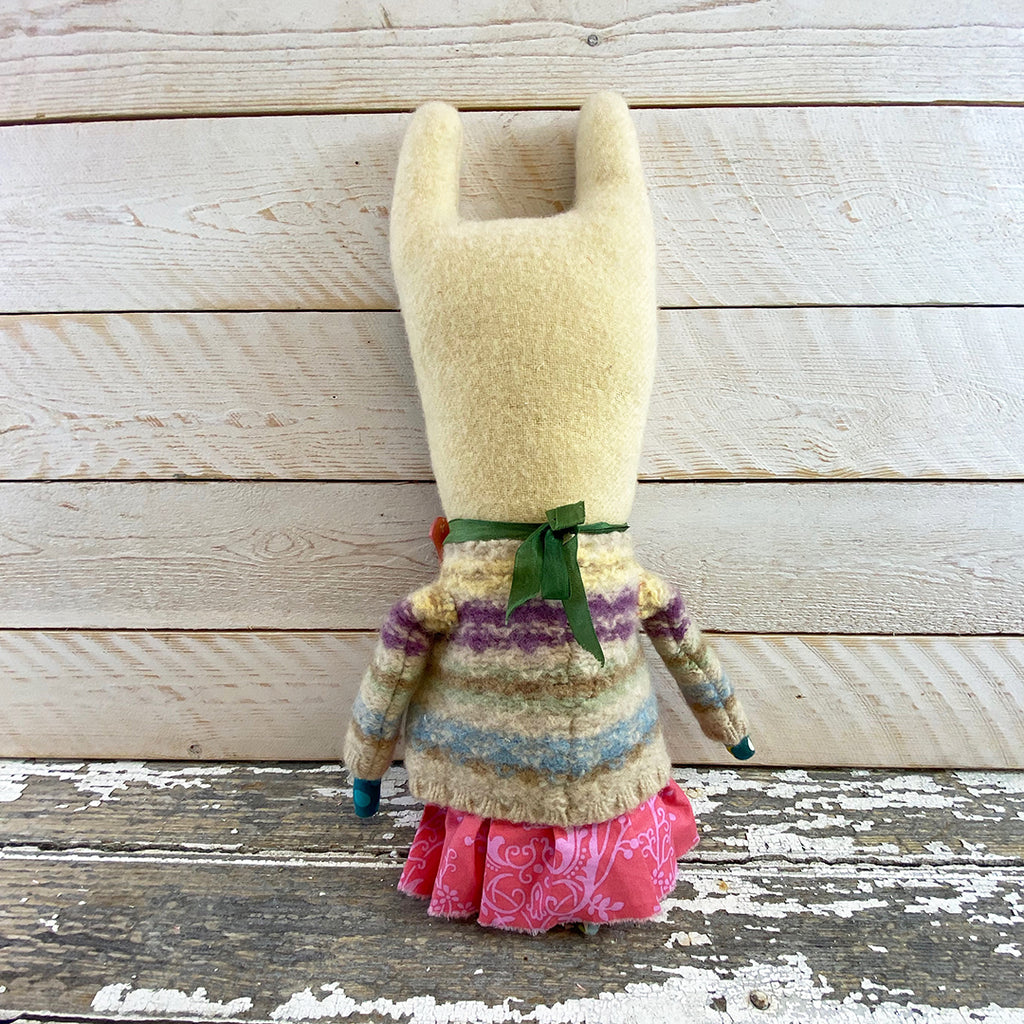 Valerie Weberpal creature with knitted cardigan.