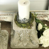 concrete pedestal with white candle
