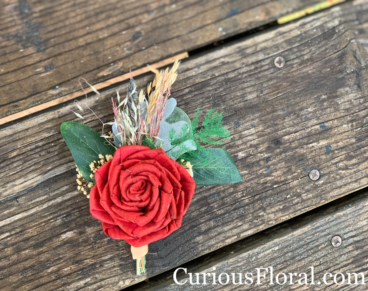 Groom sola wood rose red boutonnière, desert wedding