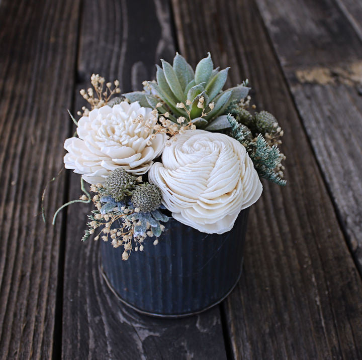 Small floral arrangement wedding reception centerpiece