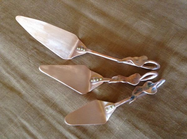 Set of three copper Brie,quiche,pie serving pieces