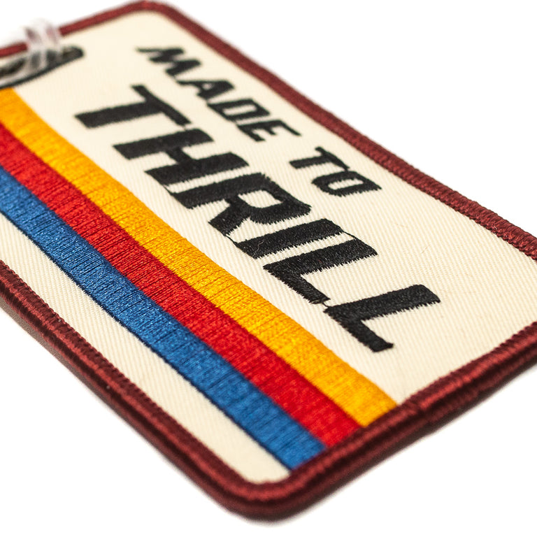 Made to Thrill Retro Luggage Tag - Detail