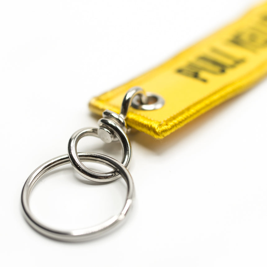 Pull The Yellow Strap Keychain