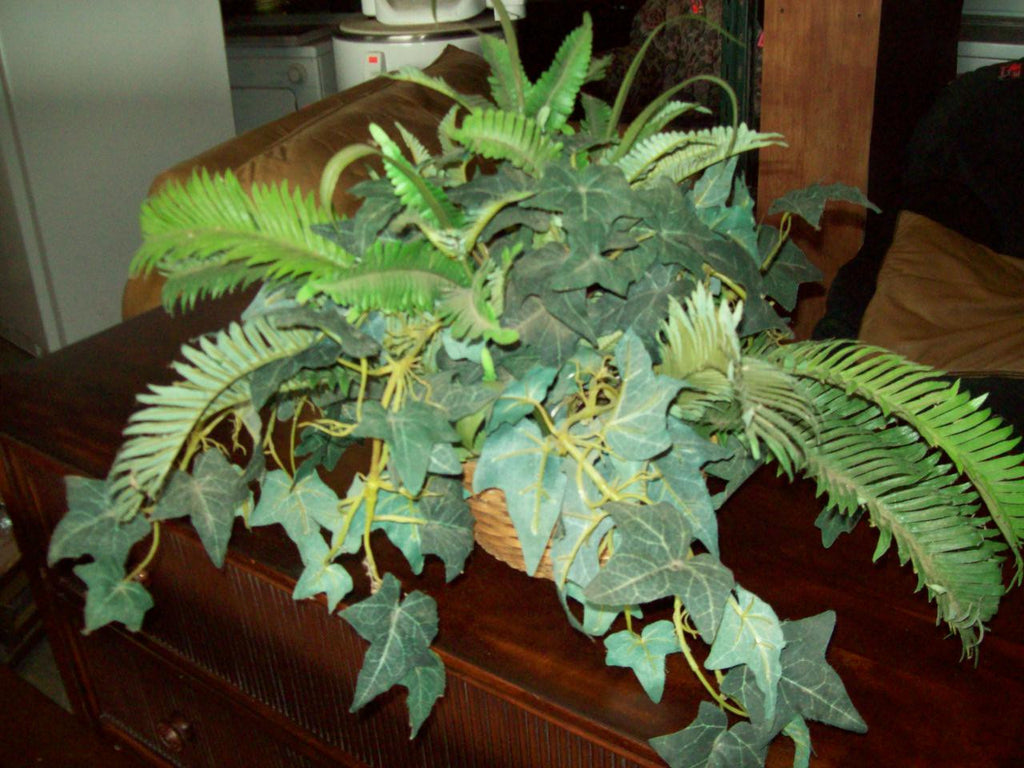 Faux plant in basket 19429