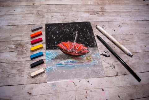 chalk pastel drawing of a umbrella with a dark sky
