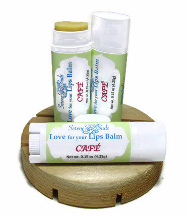 "alt = ""lip balm no sugar moisturizing oils coffee butter oval tube"""