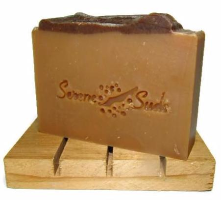 "alt = ""Yuletide Spiced Apple Cider bar soap on cedar deck with package label"""
