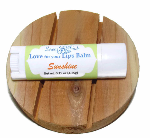 "alt = ""lip balm coconut oil mango butter UV protection sunshine"""