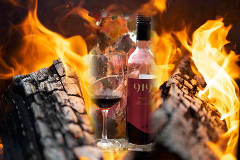 Bottle of 919 Wines Classic Muscat against a background of fire
