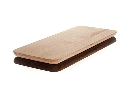 Maple side up on a rectangular cutting board composed of walnut and maple.