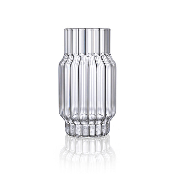 Clear, fluted vase in glass for flowers in home decor.