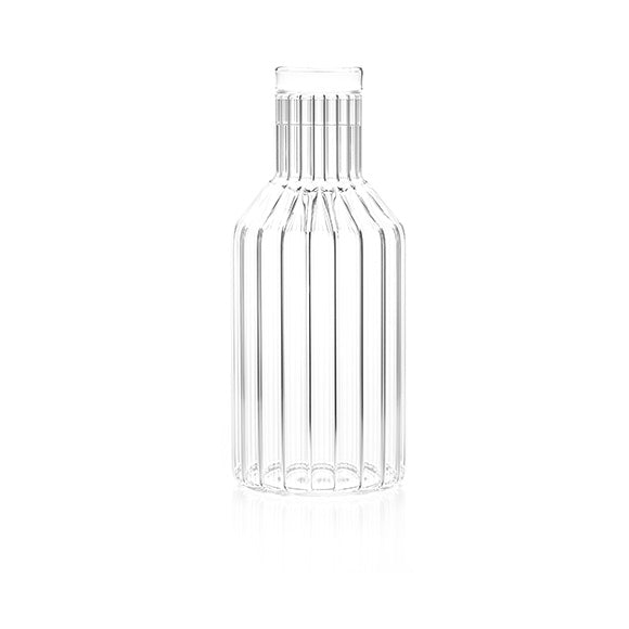 A contemporary designer decanter in fluted glass, handmade by master craftsman