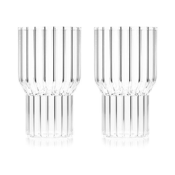 A pair of large, fluted contemporary drinking glasses by award-winning designer, Felicia Ferrone.