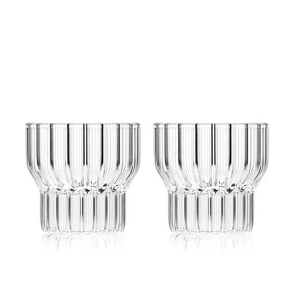 A set of two clear, low, small, fluted drinking glasses by contemporary designer, Felicia Ferrone.