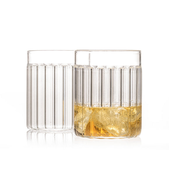 "Set of two designer tumbler glasses in fluted glass called ""Bessho Tumbler"" by Felicia Ferrone."