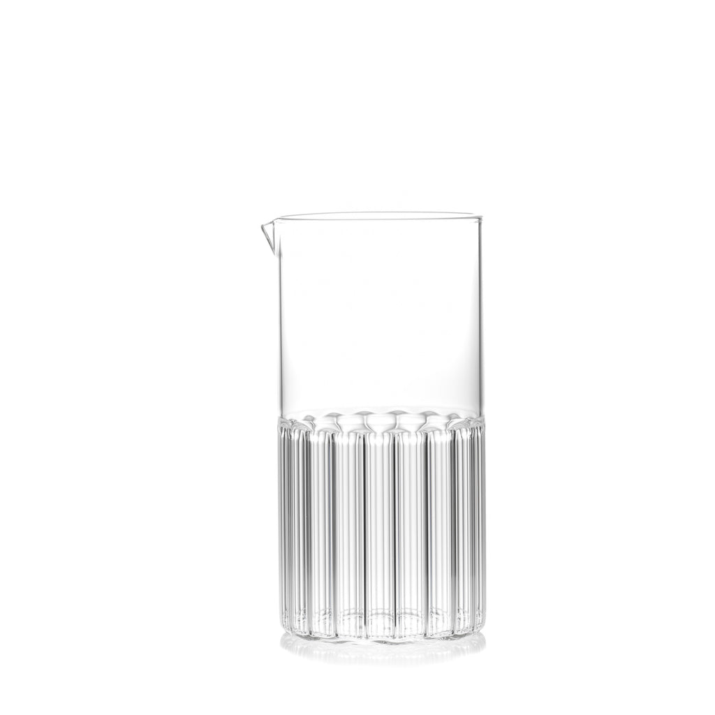 Clear, half fluted and half smooth glass carafe for water, juice or cocktails by designer Felicia Ferrone.