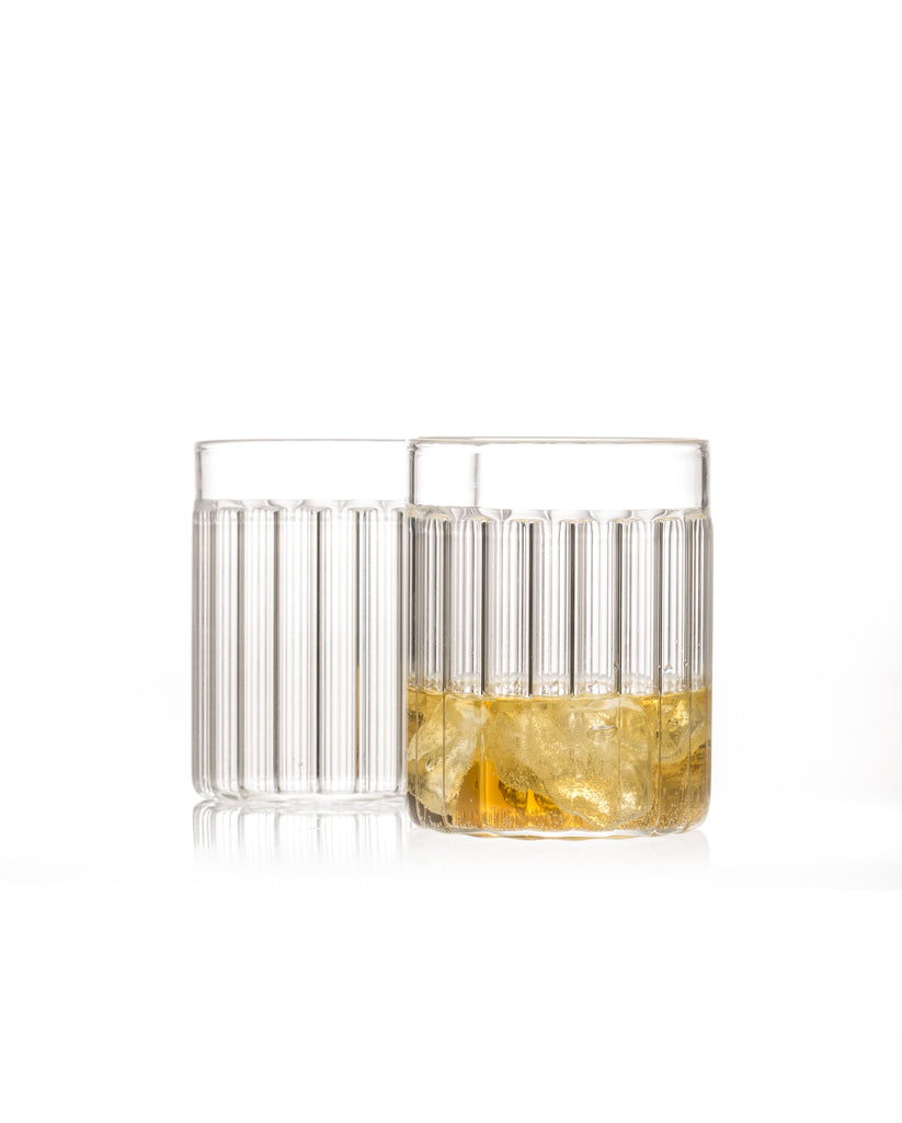 Two fluted tumbler glasses designed by Felicia Ferrone.
