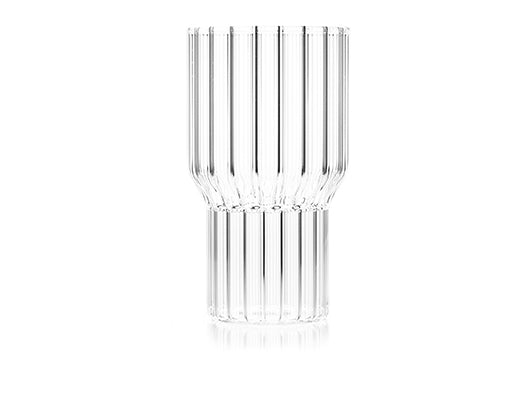 One clear, fluted, modern drinking glass by contemporary designer, Felicia Ferrone.