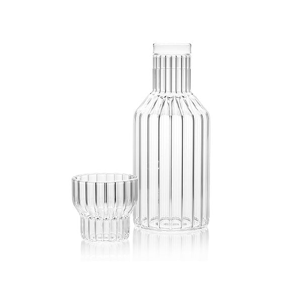 Designer bedside carafe and small glass, both in fluted glass designed by Felicia Ferrone.